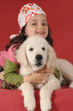Little girl with a Golden retriever Royalty Free Stock Photography