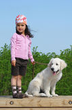 Little girl with a Golden retriever Royalty Free Stock Photo