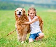 Little girl with golden retriever Stock Photos
