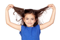 Little girl grabbing her hair. Isolated on a over white background Royalty Free Stock Photography
