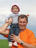 Little girl with grandfather stock photography