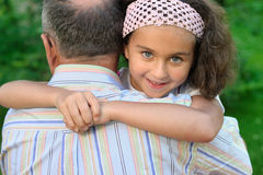 Little girl and grandfather Stock Photography