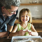 Little Girl Grandfather Bake Cookie Concept royalty free stock photo