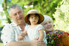 Little girl with grandfathers Royalty Free Stock Photos