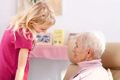 Little girl with grandmother Stock Images