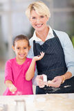 Little girl grandmother baking Royalty Free Stock Photo