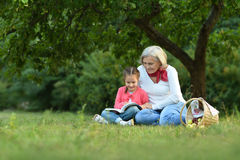 Little  girl with grandmother  and book Royalty Free Stock Images