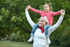 Little  girl with grandmother  in  park Stock Photos