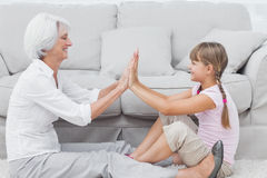 Little girl and grandmother playing together Royalty Free Stock Photos
