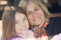 Little girl and grandmother smiling Stock Image