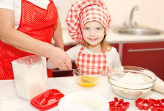 Little girl and grandmother stirrring cookie dough Royalty Free Stock Photography