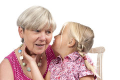 Little girl with grandmother on white Stock Photography