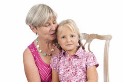 Little girl with grandmother on white Royalty Free Stock Images