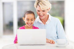 Little girl granny laptop Royalty Free Stock Images