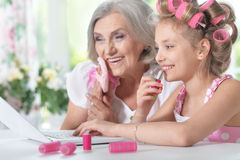 Little girl   with granny using laptop Royalty Free Stock Photo