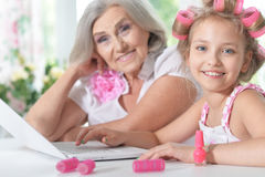 Little girl   with granny using laptop Stock Photo