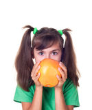 Little girl with grapefruit Royalty Free Stock Photos