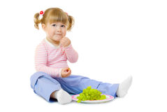 Little girl with grapes Royalty Free Stock Images