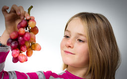 Little girl with grapes Royalty Free Stock Photos