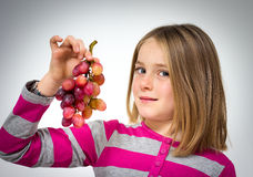 Little girl with grapes Royalty Free Stock Image