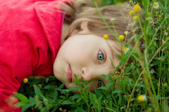 Little girl on the grass Royalty Free Stock Photo