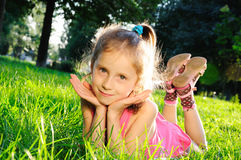 Little girl on grass Royalty Free Stock Image