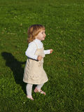 Little girl on the grass. In summer Stock Photo