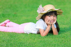 Little girl on grass Stock Images