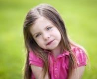 Little girl on grass Stock Image