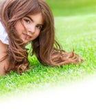 Little girl on the grass Stock Image