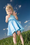 Little girl with grass in hands Stock Images