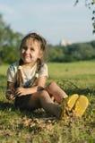 Little girl  on the grass in summertime Stock Photos