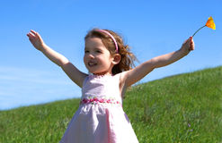 Little girl in a grassy meadow Royalty Free Stock Photos