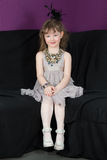 Little girl in a gray dress in elegant necklace Stock Photography