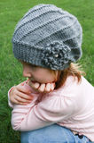 Little girl in gray hat and pink sweater Royalty Free Stock Image