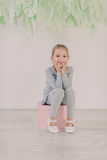 Little girl in a gray suit Stock Photos