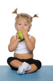 Little girl with green apple Stock Photo