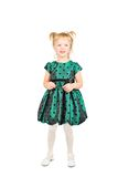 Little girl in the green dress. Stock Photos