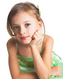 A little girl in green dress Stock Images