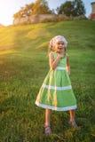 Little girl in green dress Stock Photography