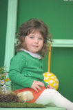 Little girl in a green dress. With chicken Royalty Free Stock Photos