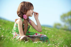 Little girl at green field Royalty Free Stock Photo