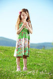 Little girl at green field Royalty Free Stock Image