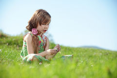 Little girl at green field Royalty Free Stock Images