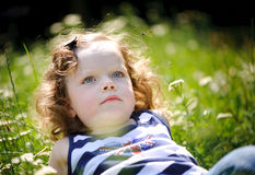 Little girl in a green field Royalty Free Stock Images