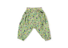 A little girl green flowered pants pants Stock Photography