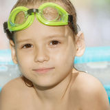 Little girl in green goggles Stock Photography