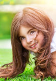 Little girl on green grass Royalty Free Stock Photo