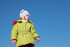 Little girl in green jacket at winter Stock Image