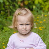 Little girl on a green lawn Royalty Free Stock Photos